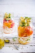 Fennel and orange salad with avocado and citrus vinaigrette in a glass jar