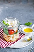 Pasta caprese in a glass jar