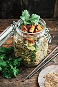 Otsu salad in a jar, vegan, with buckwheat noodles, cucumber, cilantro, tofu, spring onions, chili, roasted sesame oil and ginger  (Japan)