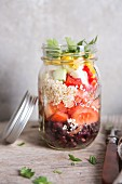 Quinoa salad with vegetables in a glass jar