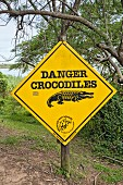 A sign warning of crocodiles in the iSimangaliso Wetland Park, a wildlife park in South Africa