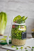 Bean and egg salad with quinoa and minted dressing in a jar for lunch
