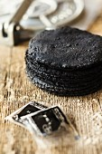 Black tortillas on a wooden surface (Mexico)