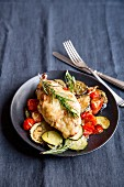 Chicken on a bed of ratatouille with rosemary