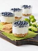 Key lime pie with blueberries in glasses (USA)