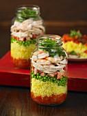 Layered paella in a glass jars