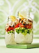 Souvlaki with rice and vegetables in glass jars (Greece)