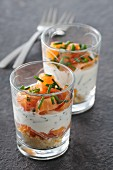Savoury layered hors d'oeuvres with two types of salmon and chives