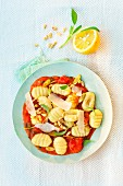 Gnocchi in tomato and lemon sauce with parmesan and pine nuts