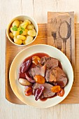 Roast beef with apricots, potatoes and shallots