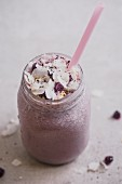 Blueberry and banana smoothie with oats, coconut milk and berry powder