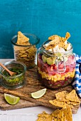 A Mexican bean salad with a honey and lime dressing in a glass jar