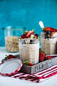 Overnight oats with fruit and nuts in a glass jar