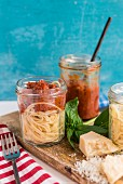 Spaghetti with roasted tomato sauce in a glass jar