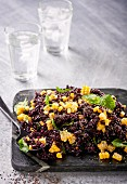 Black rice salad with sweetcorn, mint and chia seeds