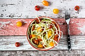 Zoodles (zucchini noodles) with tomatoes and basil
