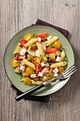 Mediterranean pasta salad with tomatoes, onions and feta