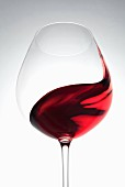 Red wine being swirled in a glass