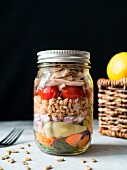Chicken and farro salad in a mason jar