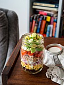 Layered salad with tuna, cauliflower and rice in a jar