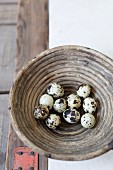 Quail eggs in a cane bowl (top view)