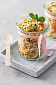 Mixed grain and vegetable salad in a glass