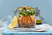 Buckwheat and sweet potato salad with cornflakes, edamame and crispy tofu in a glass jar