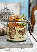Vegan couscous and roasted vegetables in a jar