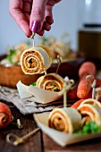 Vegan tortilla rolls with carrots on skewers