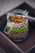 Spelt pasta, peas, broccoli, roasted chickpeas and dill sauce in a glass jar