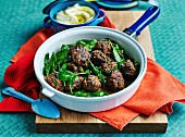 Beef and herbs meatballs with spinach,