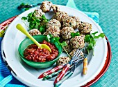Chicken sesame meatballs with sweet and sour tomato sauce