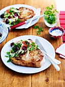 Pork chops with a cherry citrus salad