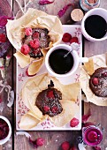 Chocolate Raspberry Muffins with coffee on a pink plate