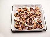 Palmiers filled with chocolate on a baking sheet