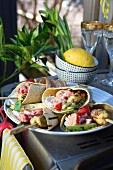 Tortillas with grilled chickpea skewers, tomatoes and jalapenos