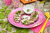 Grilled pork tenderloin slices with herbs and cold yoghurt sauce