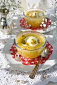 Cold passion fruit bowls with vanilla ice cream on a summer table outdoors