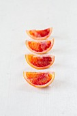 Blood orange slices in a row