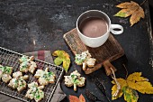 Autumnal maple biscuits with maple syrup and a cup of hot chocolate
