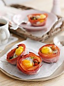 Fried ham nests with fried eggs for breakfast
