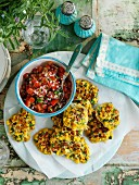 Corn cakes with herbs and tomato salsa