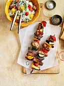 Lamb and vegetable kebabs with rice