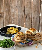 Burgers with pork chops, cheese and toasted onions