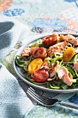 Courgette noodles with sautéed salmon and stewed tomatoes