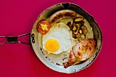English cooked breakfast in an old frying pan