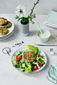 A garden salad with a horseradish dressing and fish burgers