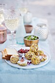 Chicken, cranberry and goat's cheese 'truffles' with pomegranate jelly