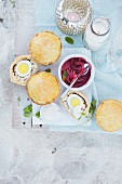Small chicken pies with eggs and red onions