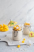 Rice pudding with coconut and mango served in a flip-top jar